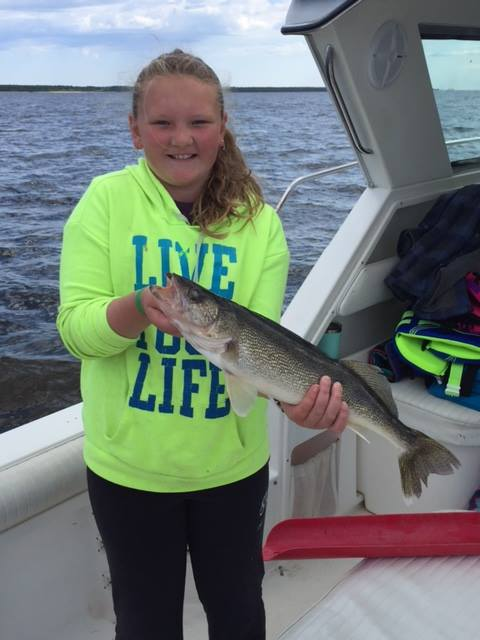 Border View Lodge_girl with pike charter boat.jpg
